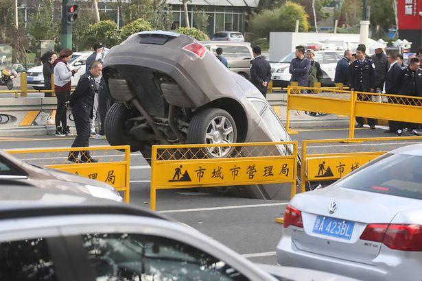 Sinkhole swallows $550,000 Rolls Royce