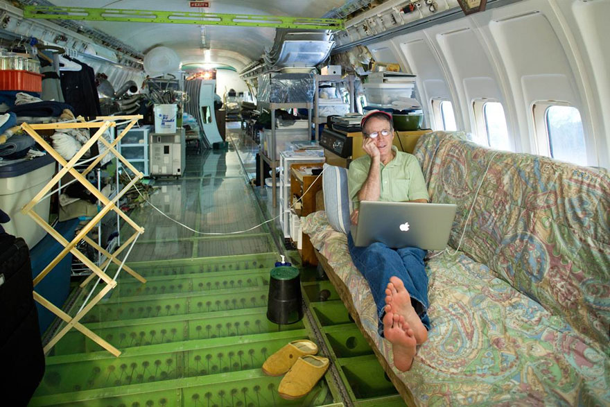 Man living in a commercial airliner in the woods